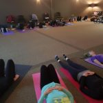Participants laying on yoga mats
