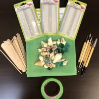 shells and glass beads and popsicle sticks