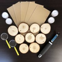 wooden discs and magnifying glasses