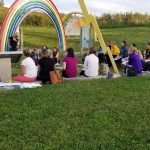 event participants seated in playground
