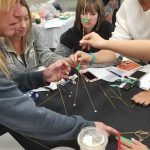 participants using string and twigs