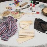 fabric and wood pieces on table