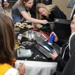participants using tools and metal pans