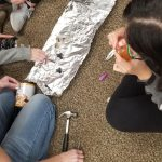 participants using tools and tin foil